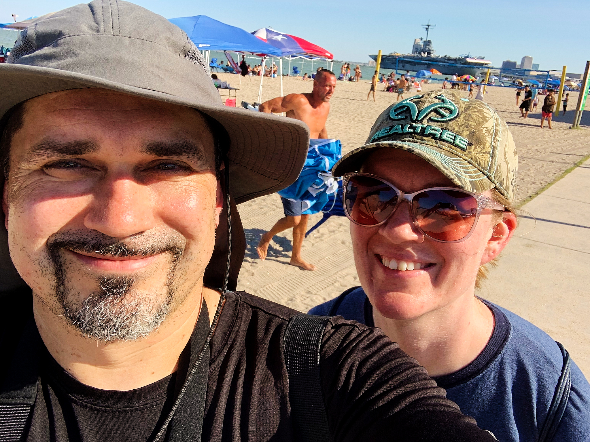 We tried to do the selfie-thing with the USS Lexington in the background but kept getting photo-bombed...so to hell with it -- dude bro in the background is here to stay.